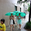 Walking to dinner with our new umbrellas.
