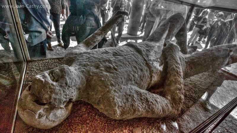 Same as previous Photo but done in mild HDR: Pompeii - the city that was buried 2000 years ago by the eruption of Mount Vesuvius. It was discovered about 150 years ago. Here one of the bodies that was un-earthed.