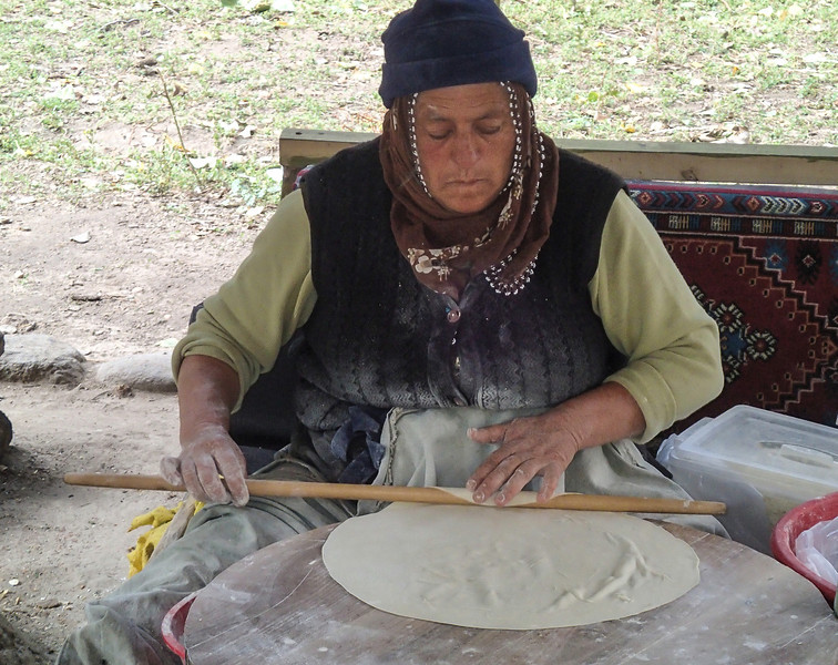 Making gözleme, a pastry made of hand-rolled dough stuffed with various savory fillings