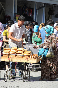 Selling the famous bread, obi non, Chorsu Bazaar in Tashkent.