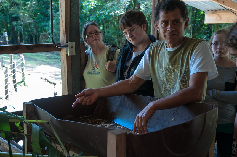 Guillermo explains how the beans are set in water - where the bad ones float and are skimmed off.