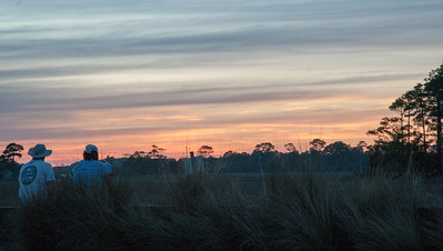 Two fishermen swap stories at sunset - Kiawah Island, SC.