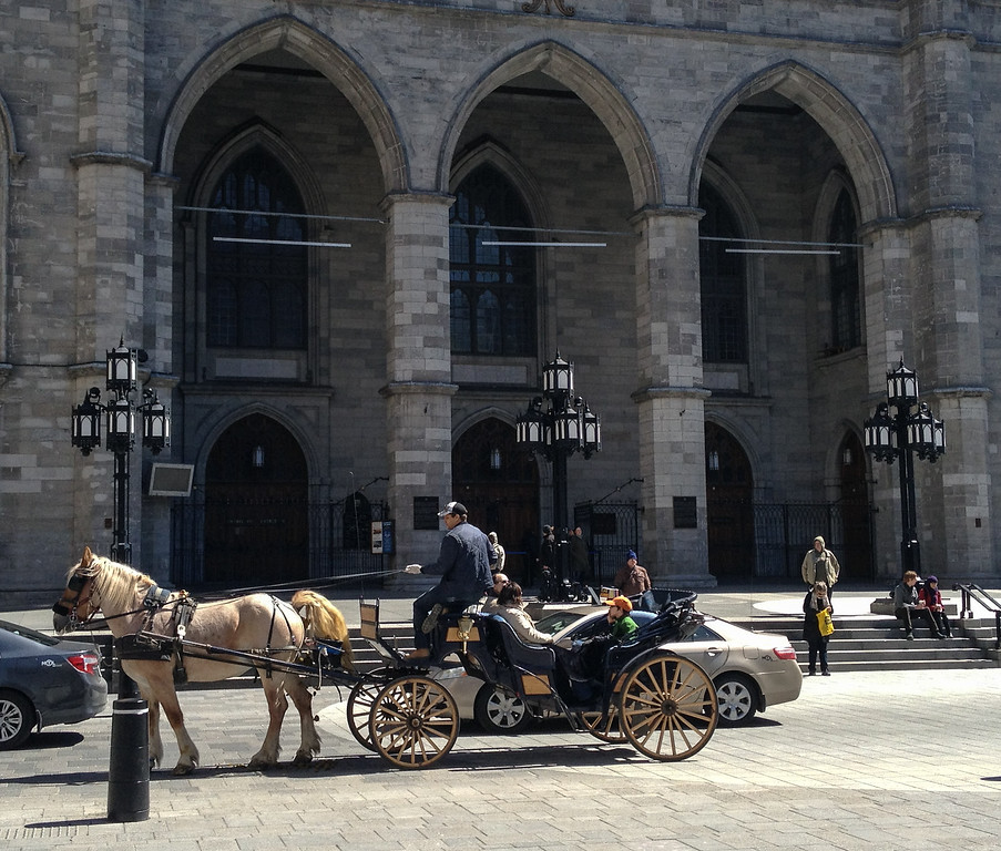 Horse-drawn carriages ply the streets in old Montreal.