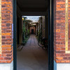 A doorway to an inner courtyard of a residential structure in downtown Copenhagen.