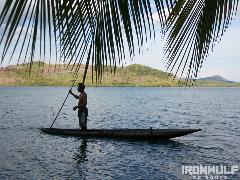 A crab farmer on his dug out canoe