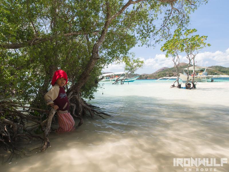 A kid under the mangrove shade at CYC Beach