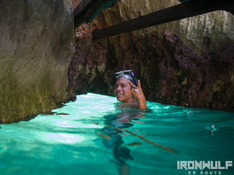 A kid about to pass through the underwater passage at the Twin Lagoons