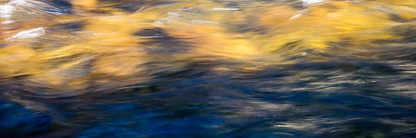 Sunlit water flowing over rocks