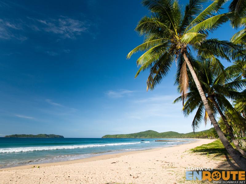 Palm-fringed white sand shores of Nacpan Beach
