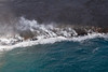 From helicopter: lava flowing into the ocean near Hawaii Vocanoes National Park