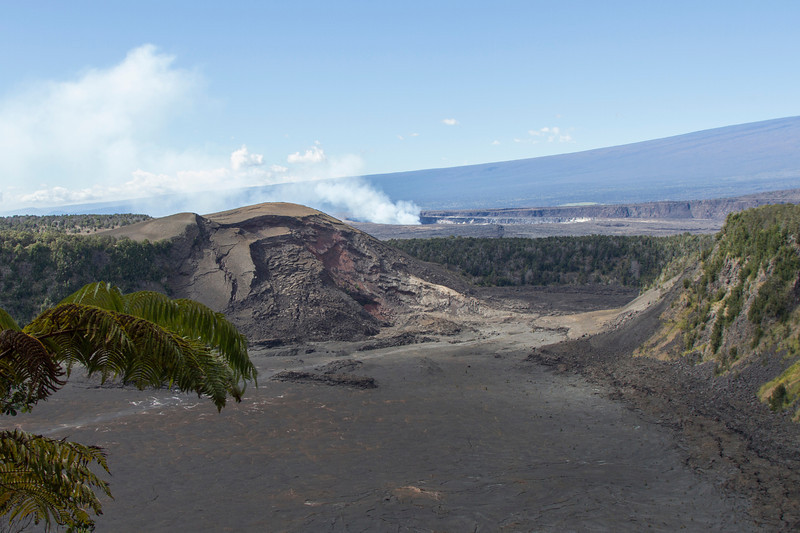 Hawaii Volcanoes Nat. Park: Kilauea Iki Trail. Kilauea Iki Crater in foreground, Halema'uma'u Crater in the distance.