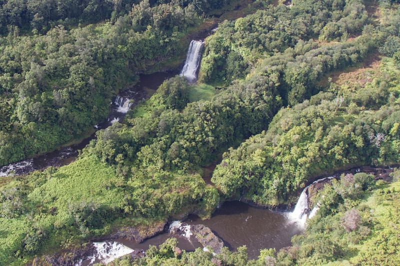 From helicopter: Wailuku River State Park, very near to Hilo, HI. Rainbow Falls at top.