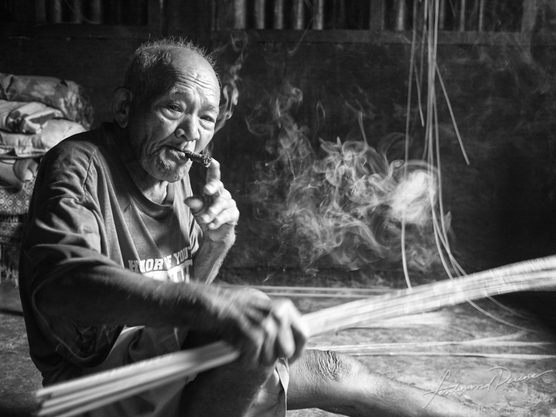 Portrait of a 93-year old broom maker