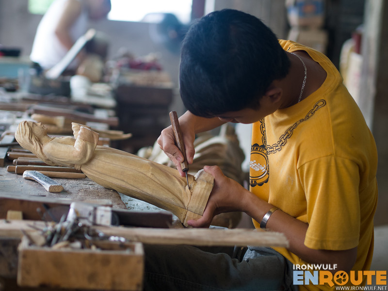 A young woodcarver working meticulously