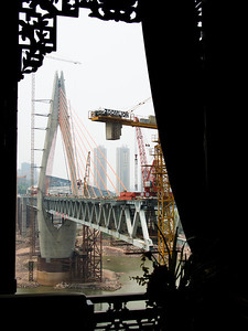 View of (Jia Ling Jiang) bridge in progress from our hotel lobby