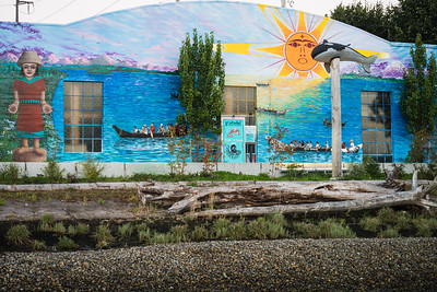 Orca Whale carving in front of the new mural