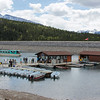 Boat tours and rentals are available from the dock area at Lake Minnewanka