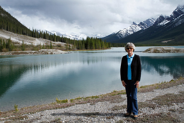 Becki poses with the beautiful scenery at Spray Lakes Reservoir
