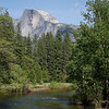 Enjoying a raft float on the Merced River with Half Dome in the background