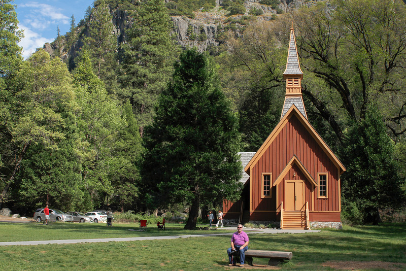 Gary has a view of Yosemite Falls (across the road) from this spot in front of The Chapel