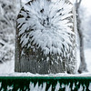 The eddies behind a fencepost draw in odd patterns of ice.