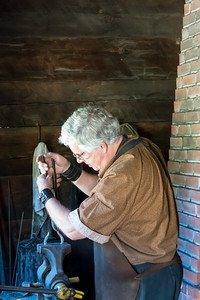 Blacksmith working at Fort Nisqually