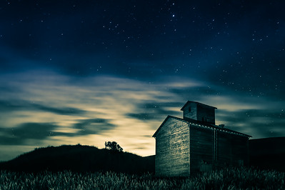 A grain elevator and the night sky