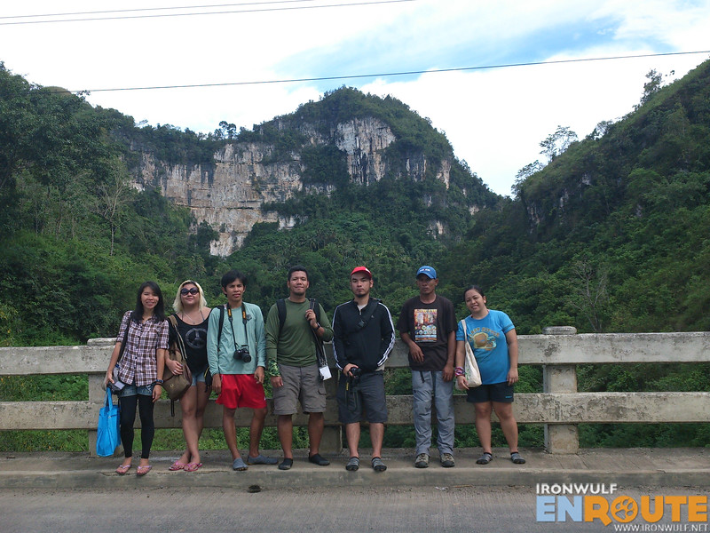 The TravelMindanao team with our belayer at Pulangi Bridge after our rappelling activity