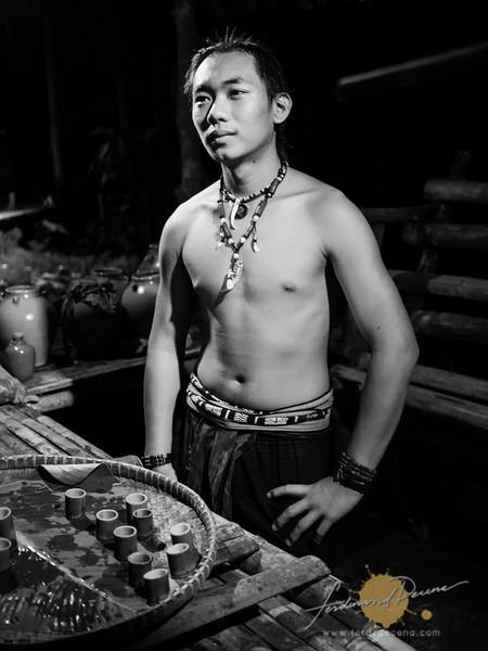 A Dusun boy distilling wine