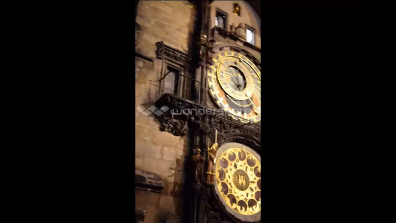 """The Clock is mounted on the southern wall of Old Town City Hall in the Old Town Square. The clock mechanism itself is composed of three main components: the astronomical dial, representing the position of the Sun and Moon in the sky and displaying various astronomical details; """"The Walk of the Apostles"""", a clockwork hourly show of figures of the Apostles and other moving sculptures—notably a figure of Death (represented by a skeleton) striking the time; and a calendar dial with medallions representing the months."""