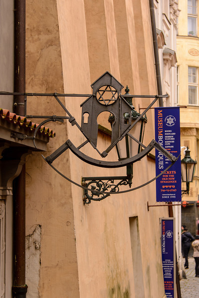 Many of the people of medieval Prague couldn't read so signs over the stores showed what the store sold or what they did.  This sign showed a synagogue