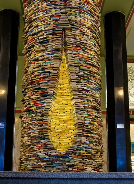 We went into the city library, and here was a floor to ceiling, circular stack of books.. When you stick your head into the yellow tear drop shape .....