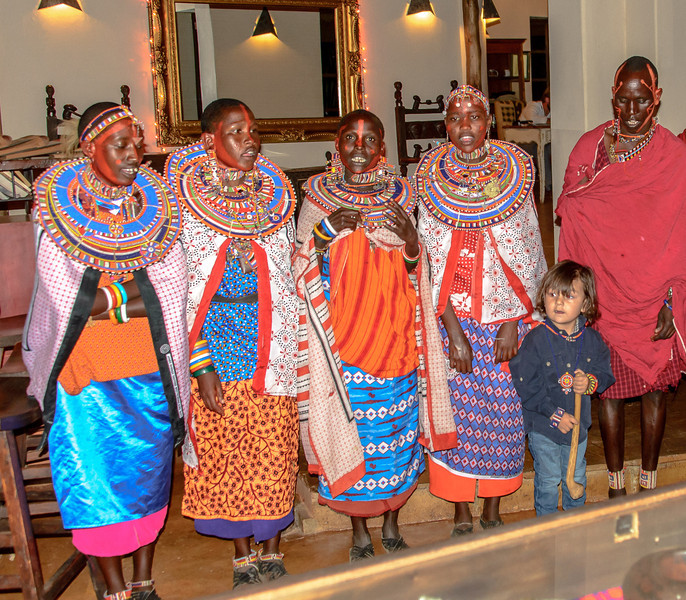 They performed in the lodge before dinner for all the guests.  Their dancing was syncopated feet shuffling and high jumping by the men.  The neck movements move the beautiful bead neck ornaments up and down on the women.  All visually stunning.<br /> <br /> The little boy is the son of the Lodge Manager who is from Holland.  The boy is living a fairly nomadic life him self with out schooling here at the lodge.  He is holding a drum beater made of an animal bone.