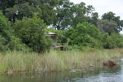 The bush palaces are tucked in along the river.