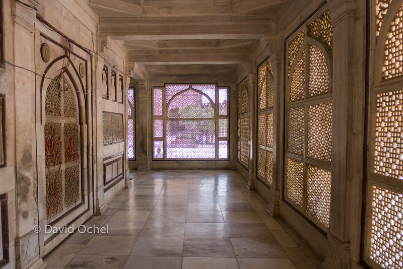 Looking out from a white marble tomb that's located in the mosque's courtyard.
