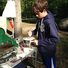 Sam helping make pancakes after our drive to the Liberty Bell store