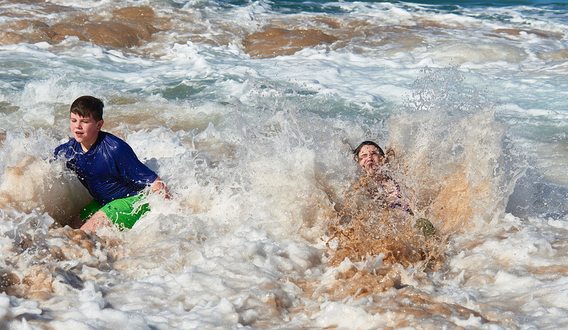 Having fun in the water at the north shore of Kauai