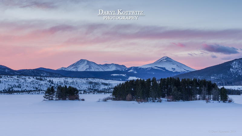 Sometimes it pays to get up early!  I spotted this potential eye-catching composition one afternoon returning to the condo after a good day of skiing.  The treed islands in icy Lake Dillon as a foreground for these snow capped mountains looked promising.  So, I set the alarm early the next morning, got myself up, drove to this area, found the spot to set my tripod, waited and shot a number of exposures as the sun began illuminating the morning.  Of the shots, this (one of the early ones) turned out the best.  The colorful sky only lasted for around 5 minutes.  I stood around in the 11 degree F temperature for over an hour that morning hoping for the sun to really illuminate the east faces of these peaks and create some added interest.  Unfortunately, that morning it didn't happen.  Still, I'm pretty happy with this capture.  Later in the day we were on the road back home to Omaha.  There's always next year.