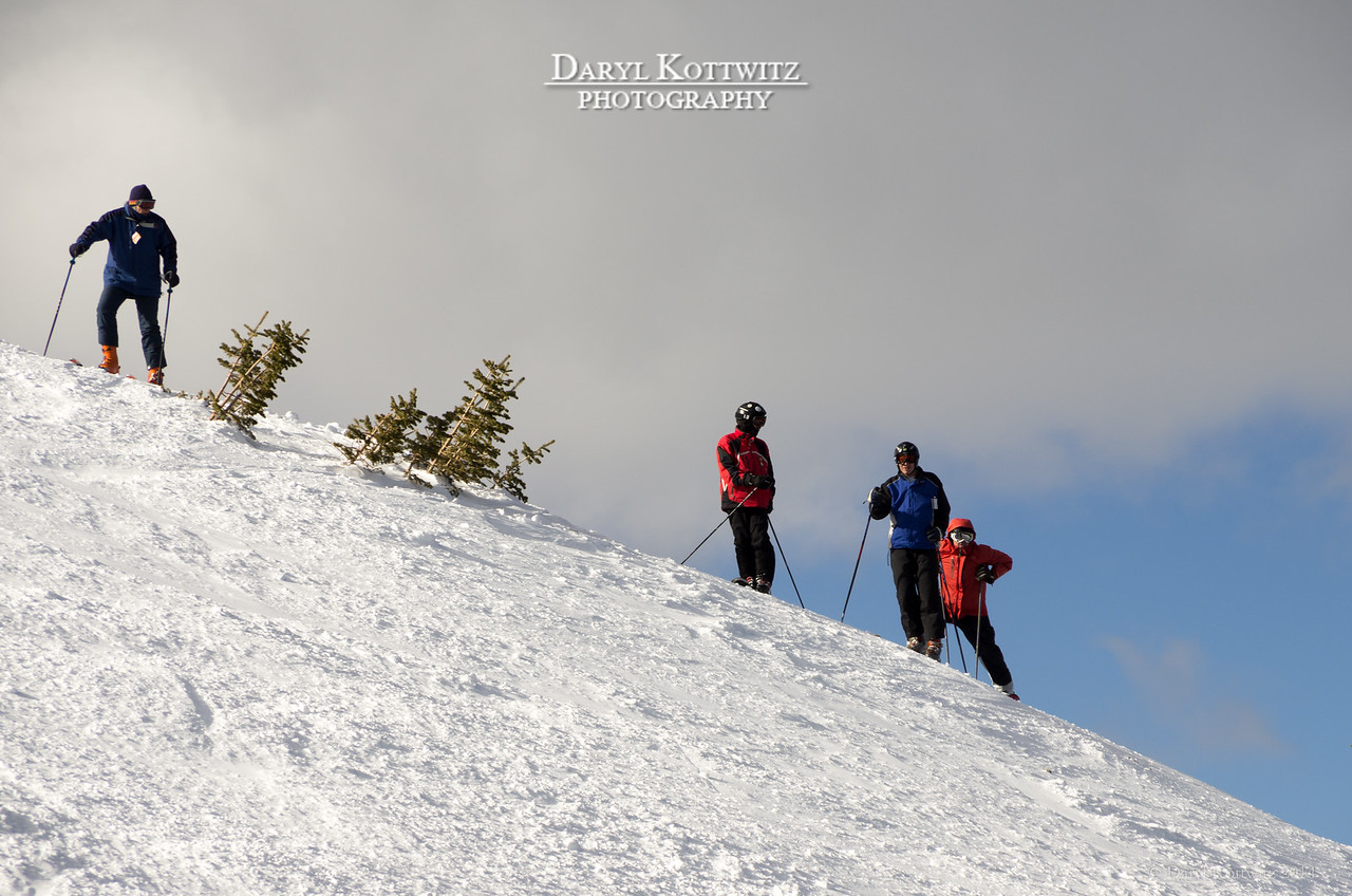 Breckenridge has opened a new peak, Peak 6, for skiing this year.  The lift ride to the top and a dose of good fortune allowed me to shoot these skiers at the very top of a steeply sloping horizon.  Glad I had the camera out and ready!