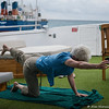 Morning yoga on the sun deck of the M/Y Eric.
