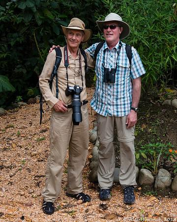 Tourists acquiting their duties as photographer and birdwatcher