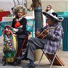 Sweet older couple singing traditional Mexican folk songs in the midst of the farmers market.