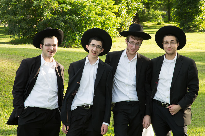 085 ...saw four young men. Jodi and I chatted with them for a while and learned they needed a ride up the mountain to Tannersville, where they were staying for two weeks. Having not enough seats in my Xterra, I dropped Jodi off at our motorhome and went back for the young men. I learned they were of the Ultra-orthodox Jewish faith, and very friendly. We had a nice chat as we rode up the steep and windy mountain road (Route 23-A). It was a pleasure meeting them and learning a few things about their culture. From left to right they are Moshe, Yehuda, Shmuel, and Aryeh. I'm sure they appreciated the ride (about 12 miles), and I certainly enjoyed their company. If Shmuel hadn't made that black-and-white comment, I never would have met them, and I never would have sent them a copy of this photo. Thanks for speaking up, Shmuel. If you don't ask you don't get.