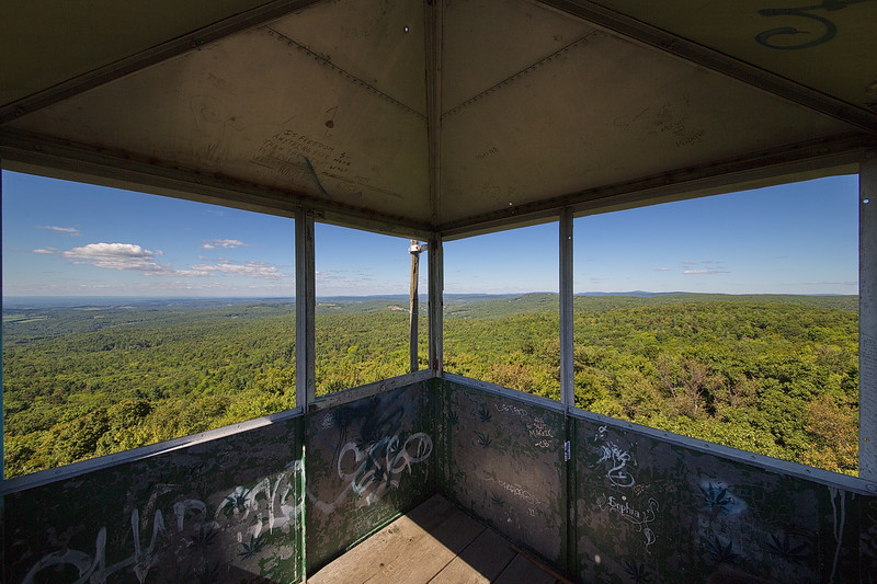 234 This ultra-wide-angled shot shows the inside of the fire tower, plus the view out to the northeast. It was taken with a Sigma 12-24mm zoom lens at 12 mm. Notice the two bullet holes in the roof.