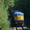 113 passes 15.75MP near Aldergrove with the Antrim branch ballast train. 040814