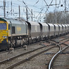 66547 rolls through Carlisle working the 0800 Fiddlers Ferry P Stn Flhh to Carlisle N.Y. empty coal. 010314