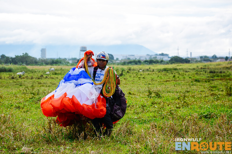 Sir Rolly Magpayo carrying his equipment after landing