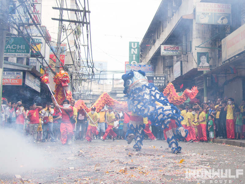 More dragon dance amidst the smoke and exploding firecrackers