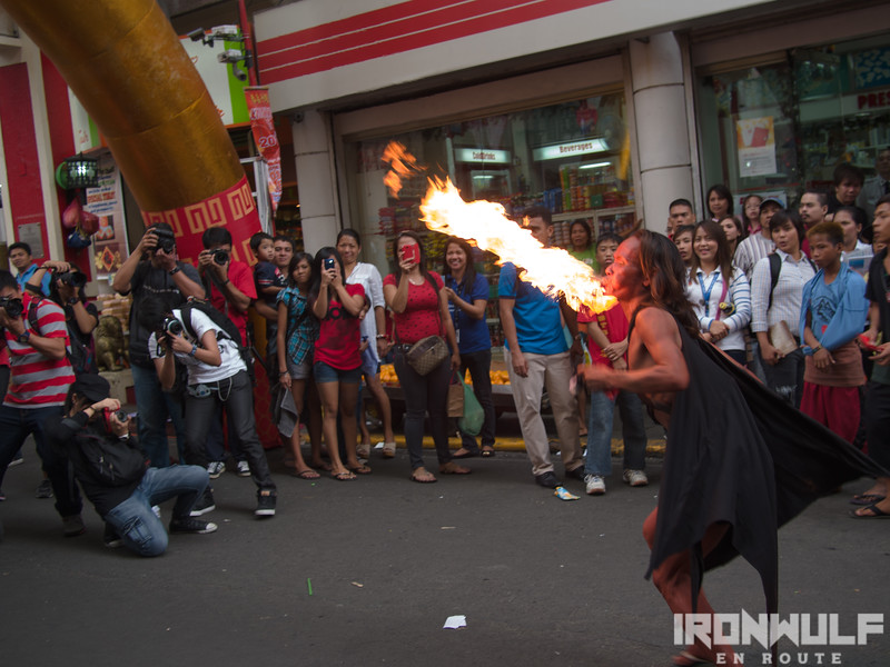 Photographers and a fire-breather