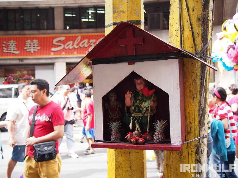 Streetside altar. Binondo shows the fusion of beliefs from Christian and Chinese
